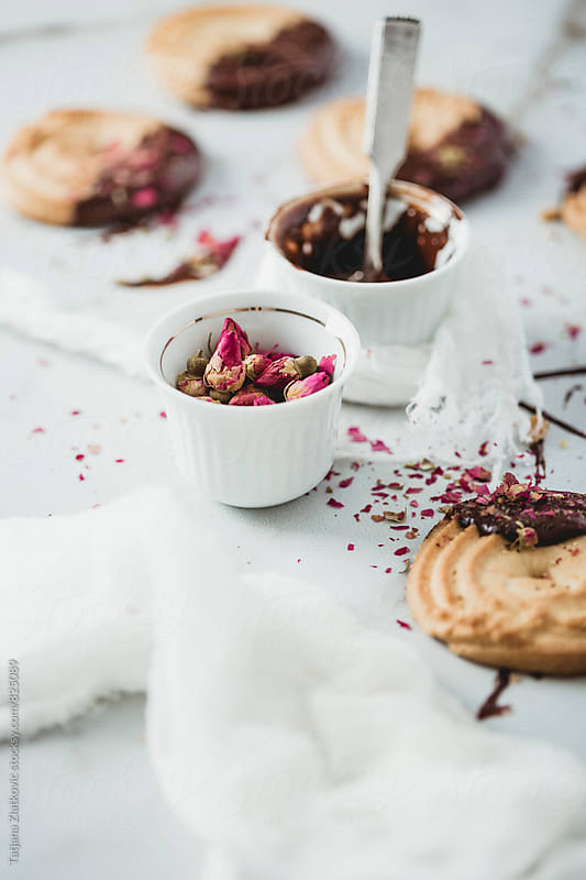 Cookies with chocolate and rose buds by Tatjana Zlatkovic for Stocksy United