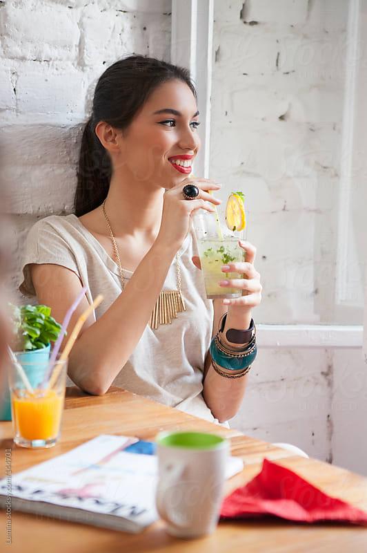 Woman Drinking Lemonade by Lumina for Stocksy United