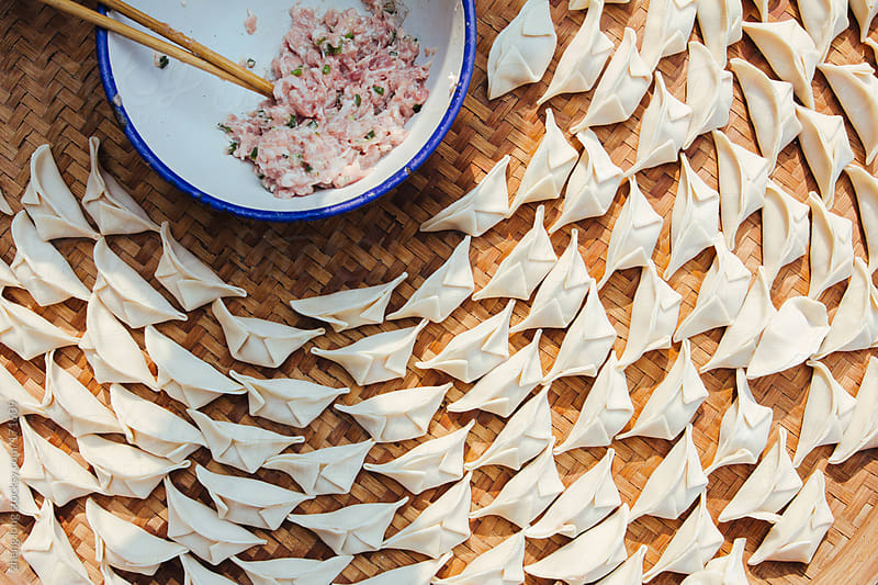 Making dumplings,to celebrate the Spring Festival by zheng long for Stocksy United