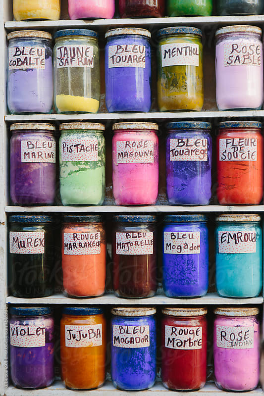 traditional dyes at a market stall in essaouira, morocco by Rebecca Zeller for Stocksy United