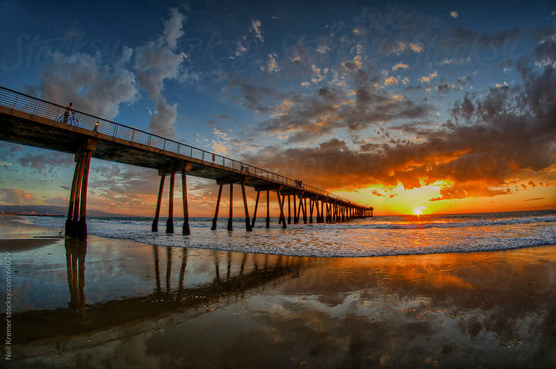 Pier and clouds by Neil Kremer for Stocksy United
