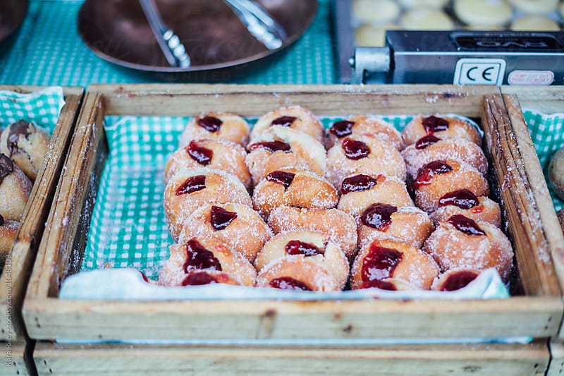 Tray of handmade Jam Donuts by Kara Riley for Stocksy United