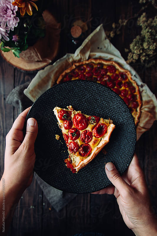 Vegan quiche with cherry tomatoes, tofu and thyme by Nataša Mandić for Stocksy United