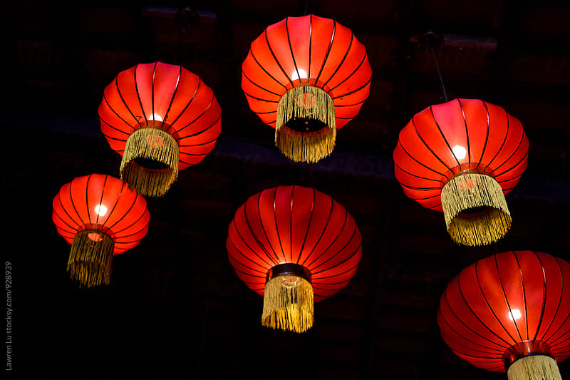 red paper chinese lanterns hanging on ceiling by Lawren Lu for Stocksy United
