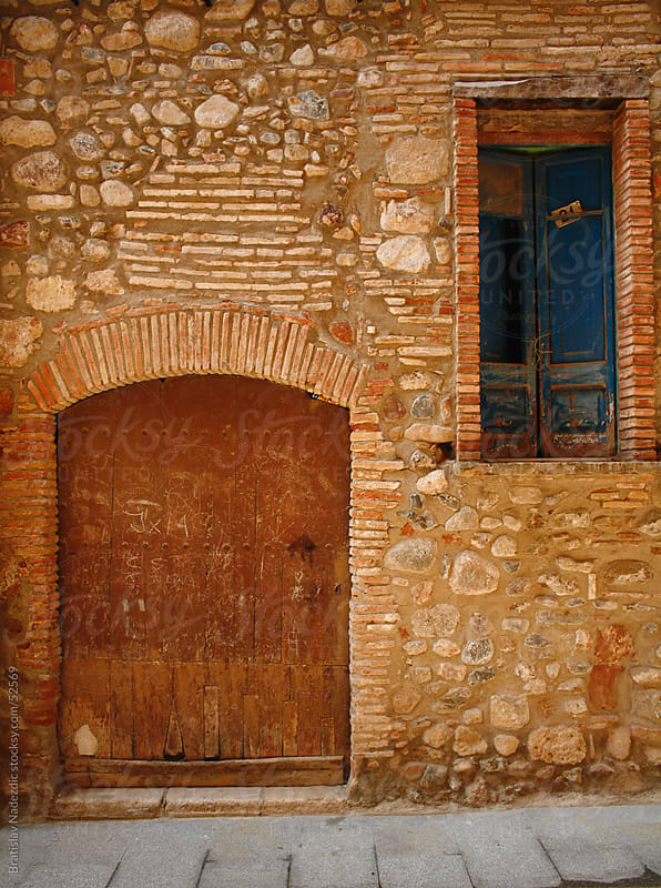 Door and window on old wall by Bratislav Nadezdic for Stocksy United