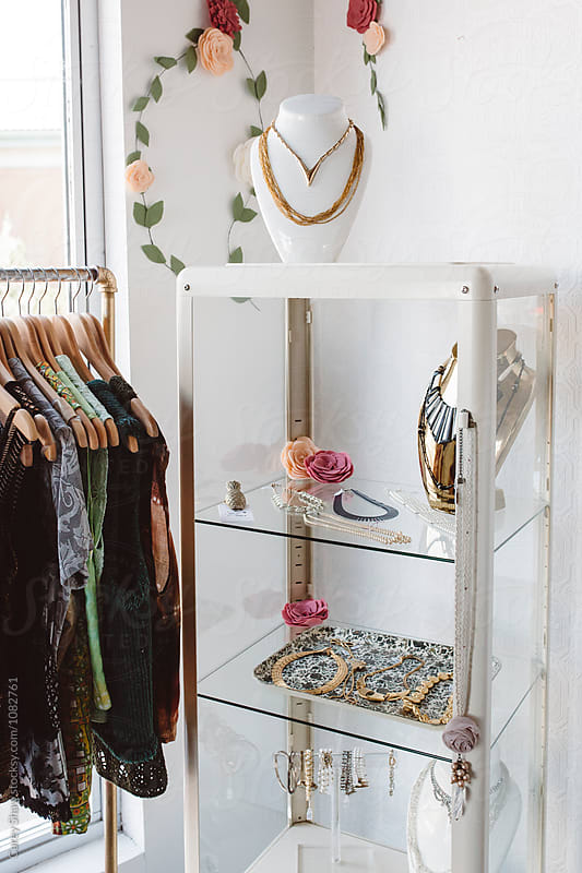 Vintage closthing on display in cute boutique by Carey Shaw for Stocksy United