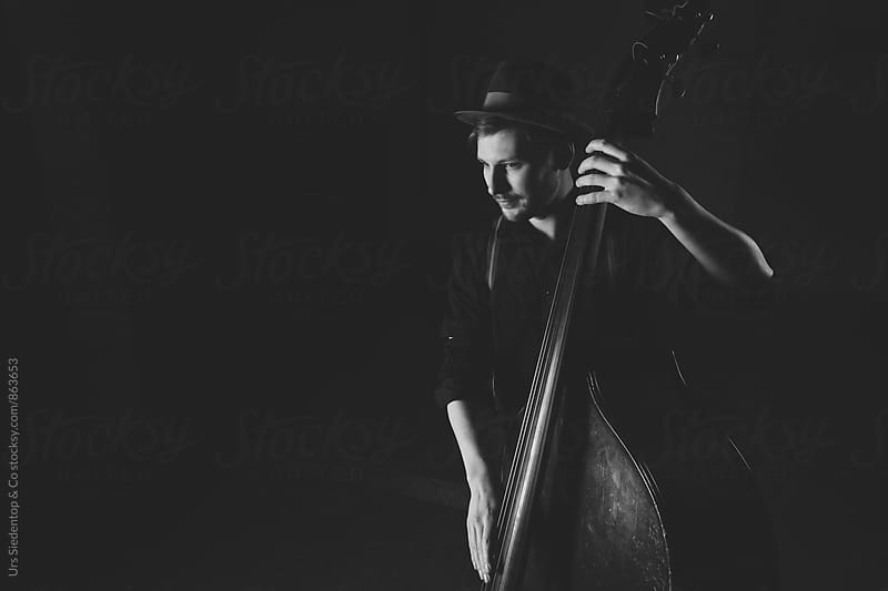 black and white image of musician with contrabass by Urs Siedentop & Co for Stocksy United