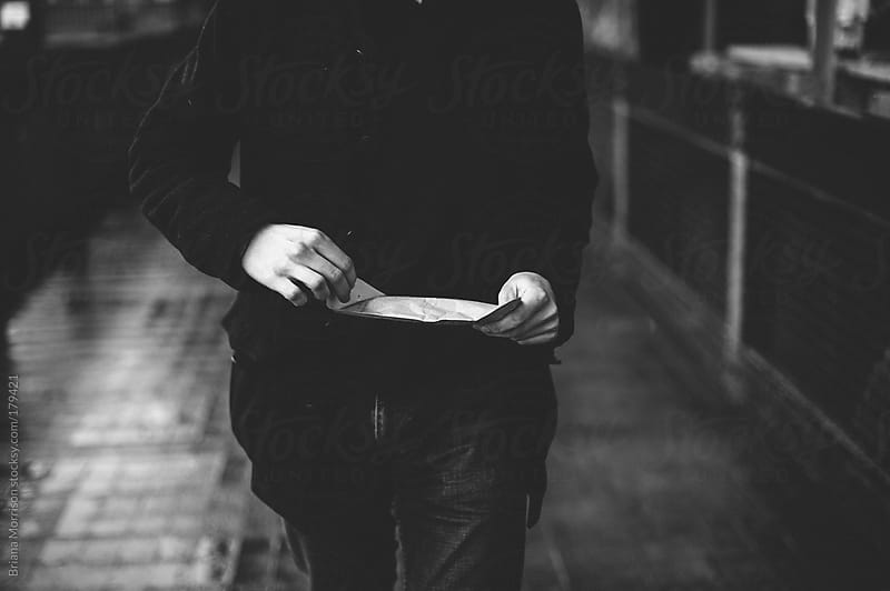 Man Opening an Envelope in Black and White by Briana Morrison for Stocksy United