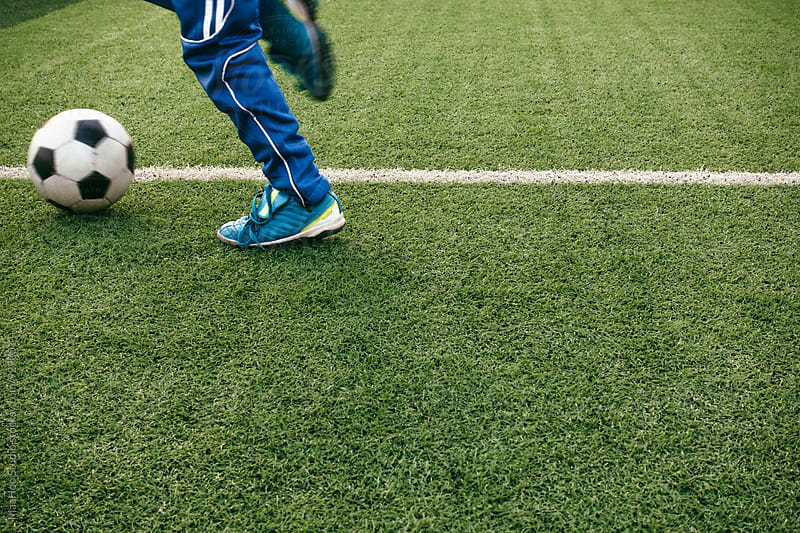 Man kicking football by MaaHoo Studio for Stocksy United