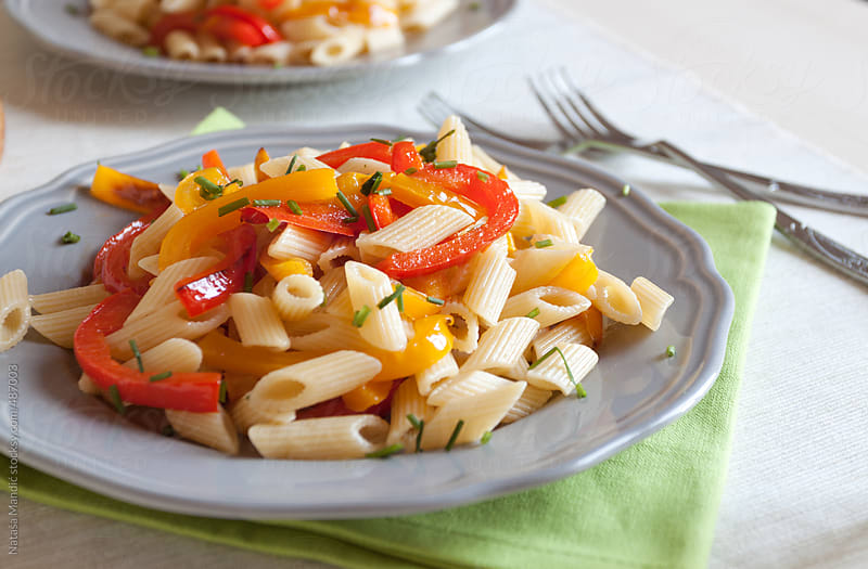 Pasta with red and yellow peppers by Nataša Mandić for Stocksy United