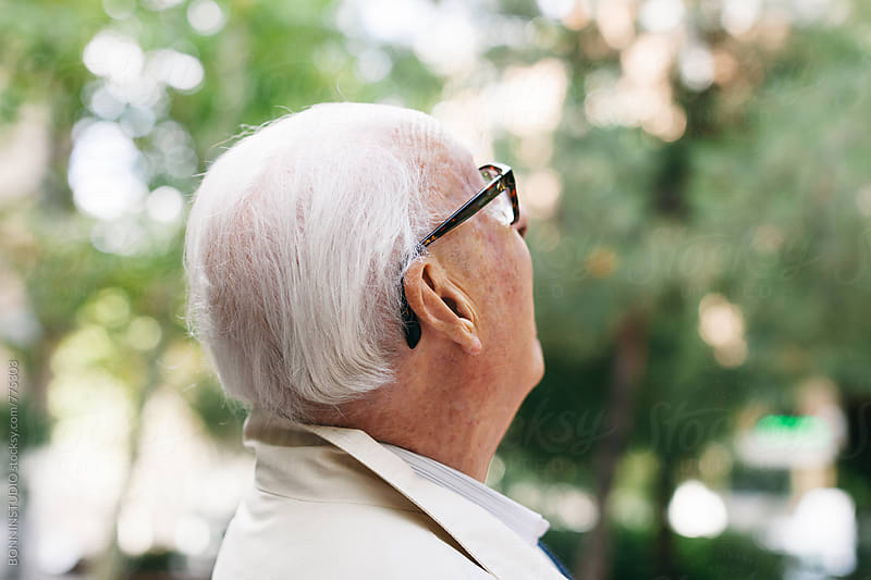 Side view of an elderly man looking up outside. by BONNINSTUDIO for Stocksy United
