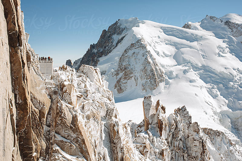 People standing on a viewing platform on the Mont Blanc Massif mountain range by Suzi Marshall for Stocksy United
