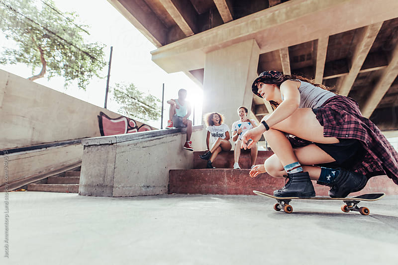Young girl riding on skateboard  by Jacob Lund for Stocksy United