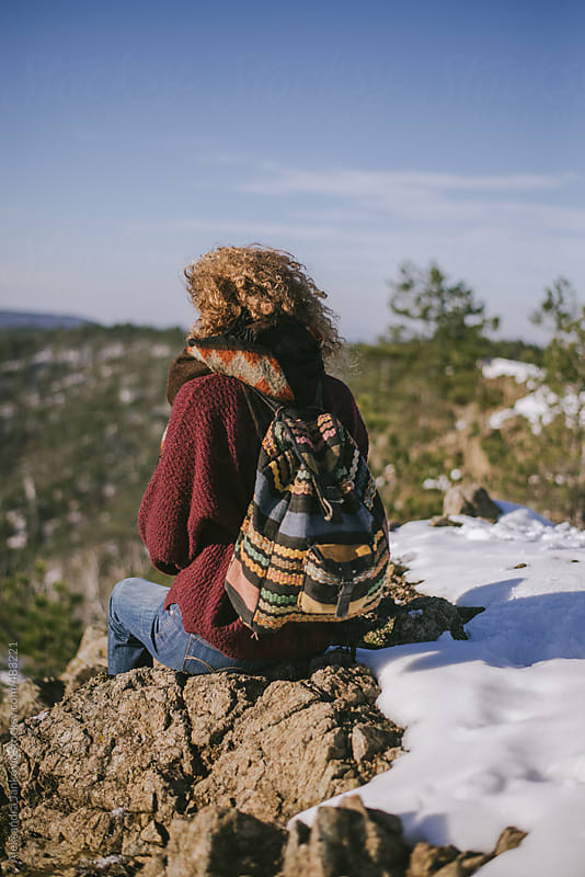 Back view of a woman relaxing at the mountain top by Aleksandra Jankovic for Stocksy United