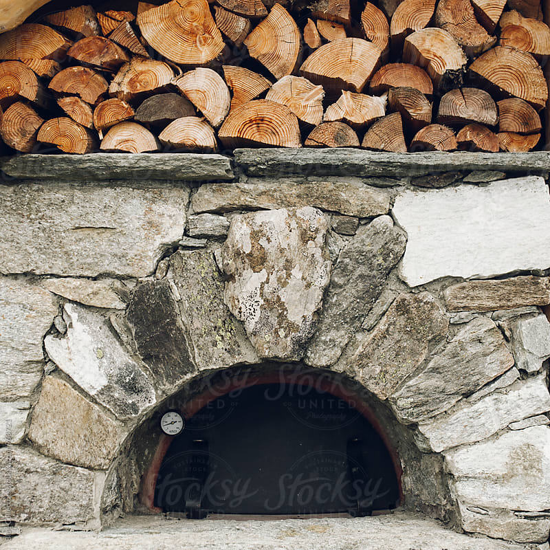 Traditional wood oven closed by Blue Collectors for Stocksy United
