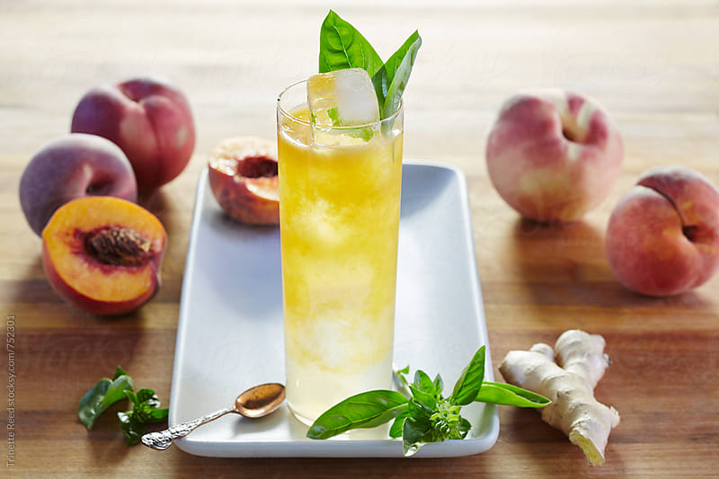 Freshly made peach cocktail with ingredients by Trinette Reed for Stocksy United