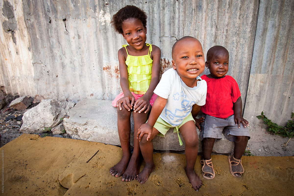 Three Cute African kids sitting outside their home by Micky ...