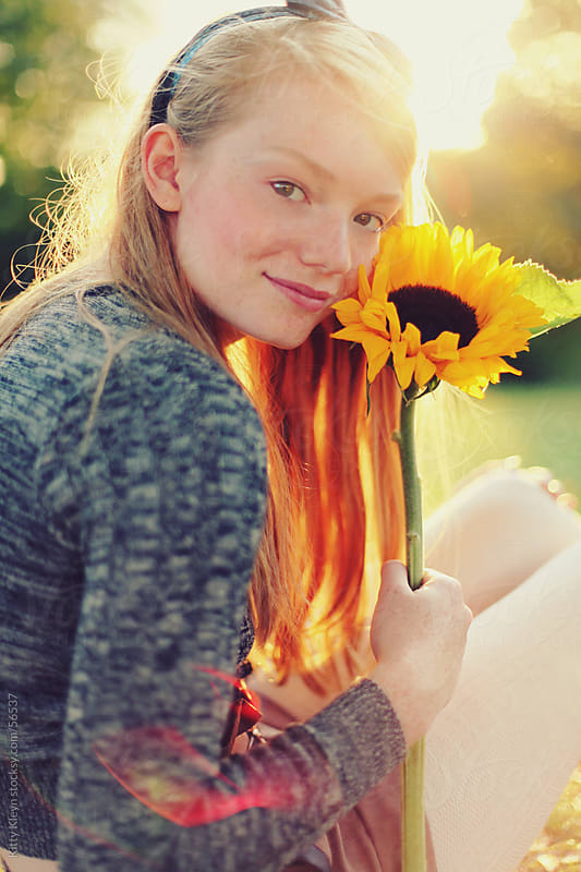 Sunflower girl by Kitty Gallannaugh for Stocksy United