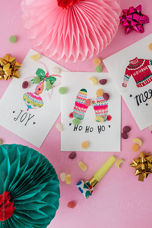 Hand Painted Christmas Cards on a Pink Background by Katarina Radovic for Stocksy United