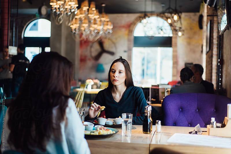 Women having a breakfast in the restaurant by Boris Jovanovic for Stocksy United