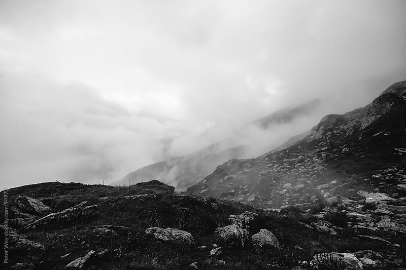 cloudy valley in the mountains by Peter Wey for Stocksy United