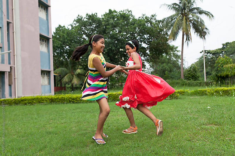 Teenage girls playing together  by PARTHA PAL for Stocksy United