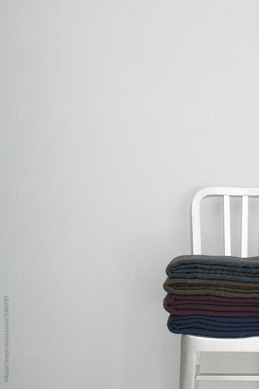 Metallic chair with handmade wool blankets by Miquel Llonch for Stocksy United
