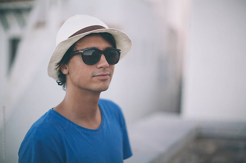 Young boy with sunglasses and hat by Javier Pardina for Stocksy United