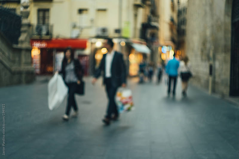 group of people walking on the shopping street by Javier Pardina for Stocksy United