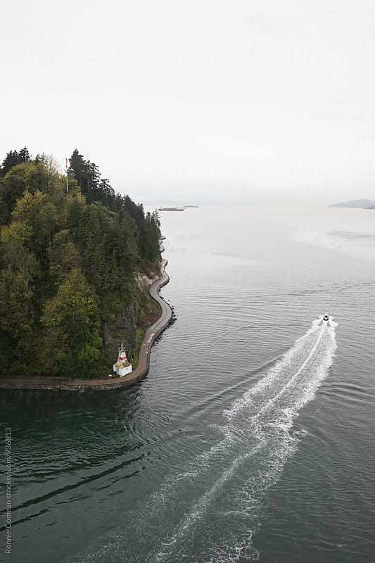 Shoreline With Seawall From Above by Ronnie Comeau for Stocksy United