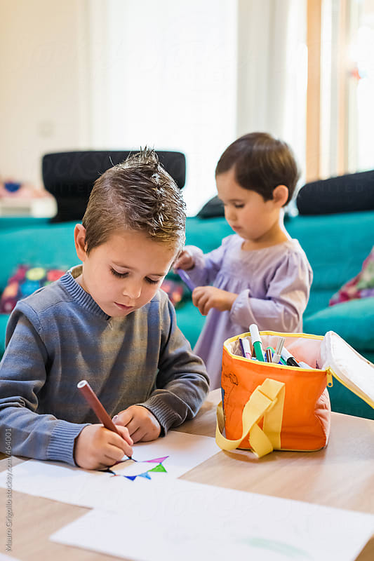 children doing homeworks at home by Mauro Grigollo for Stocksy United