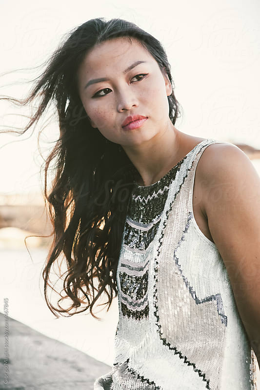 Young Asian Woman Posing in a Windy Day by Giorgio Magini for Stocksy United