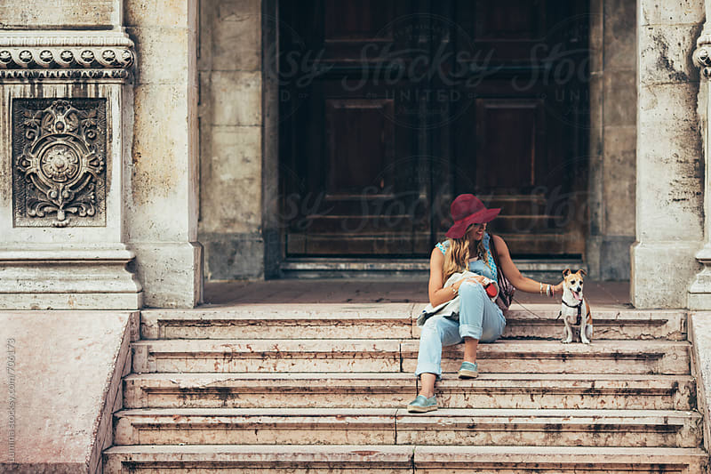 Woman With a Dog Sitting on Stairs by Lumina for Stocksy United