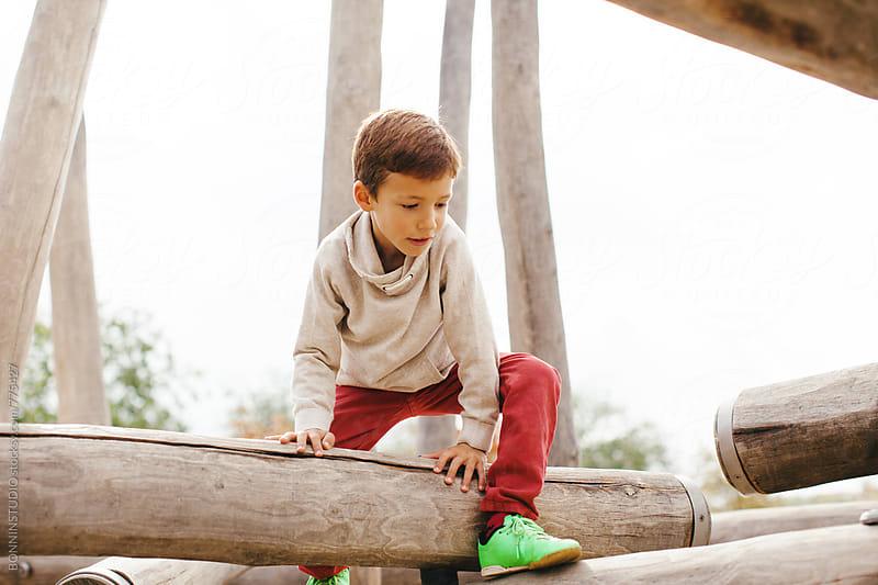 Little boy having fun in a playground. by BONNINSTUDIO for Stocksy United