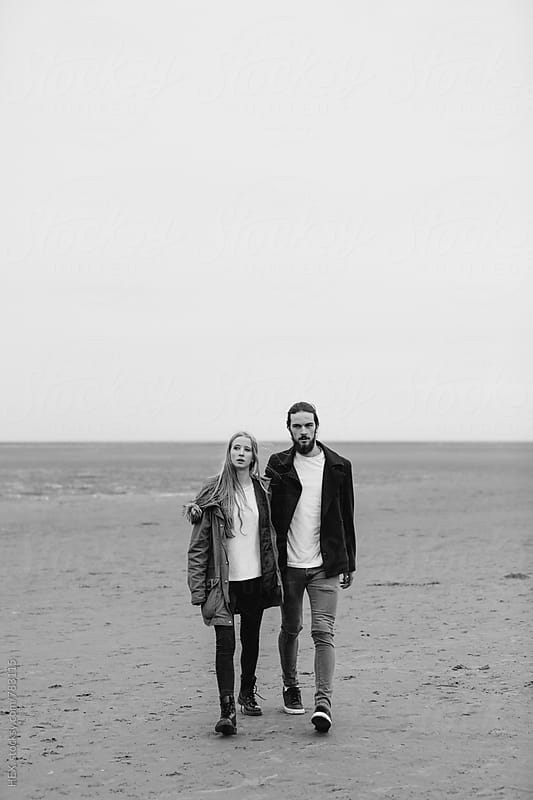 Teenage Young Couple Walking on the Beach in Autumn Time by HEX. for Stocksy United
