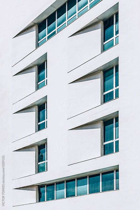 Abstract White Facade with Blue Windows by VICTOR TORRES for Stocksy United