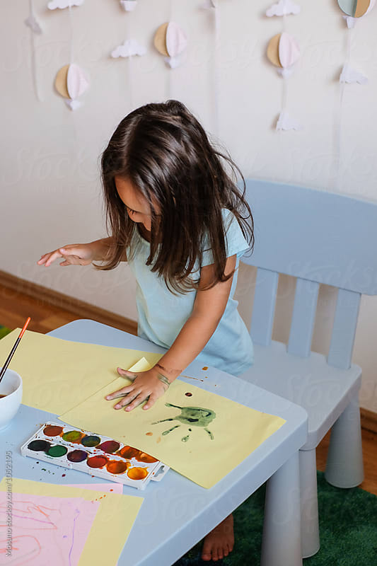 Cute Little Girl Making Palm Prints with Watercolours by Mosuno for Stocksy United