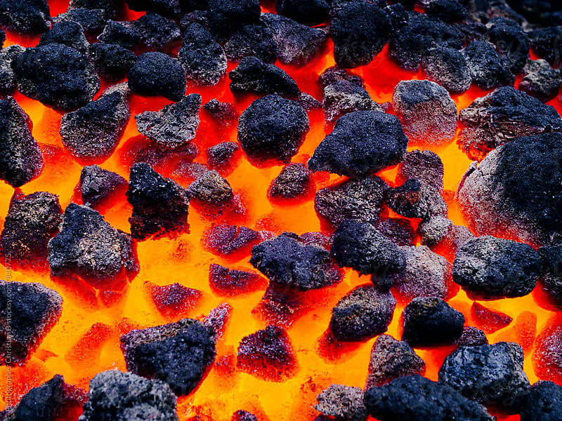 Hot coals by Photographer Christian B for Stocksy United