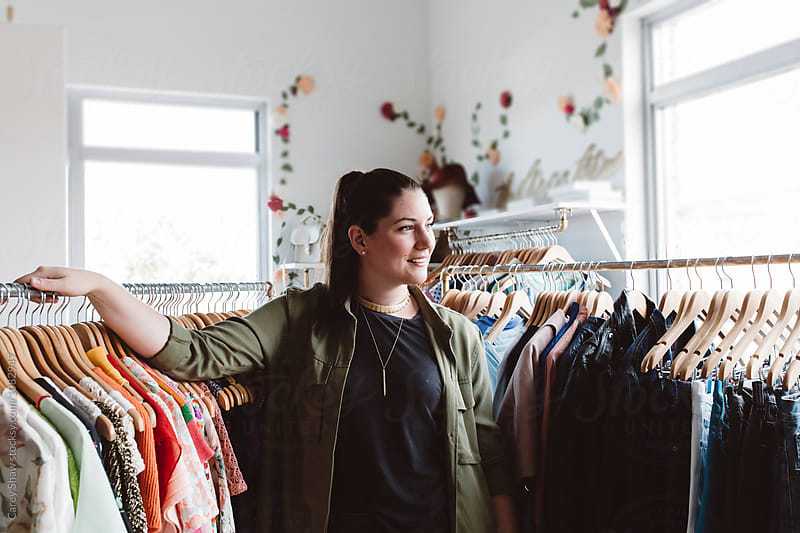 Small business owner in her clothing store by Carey Shaw for Stocksy United