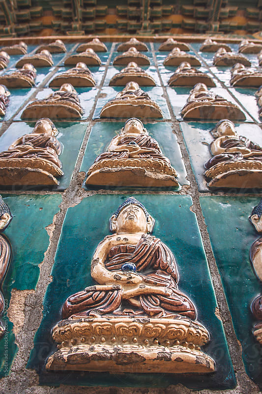 Tiles with the Buddha at the White Pagoda in Beijing by Helen Sotiriadis for Stocksy United