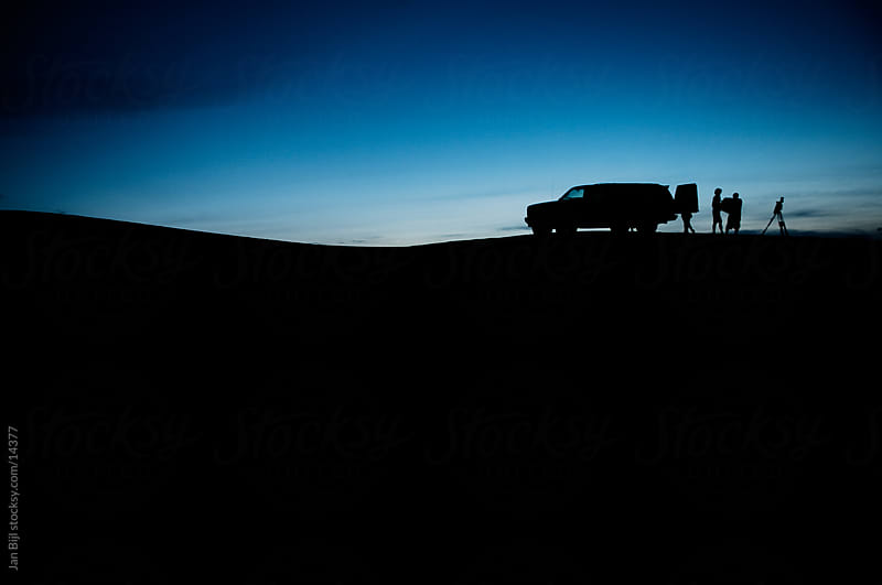 packing up the car, sunset Silhouette by Jan Bijl for Stocksy United