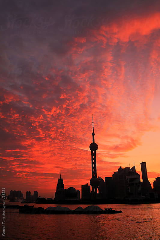 Shanghai skyline sunrise by Wenhai Tang for Stocksy United