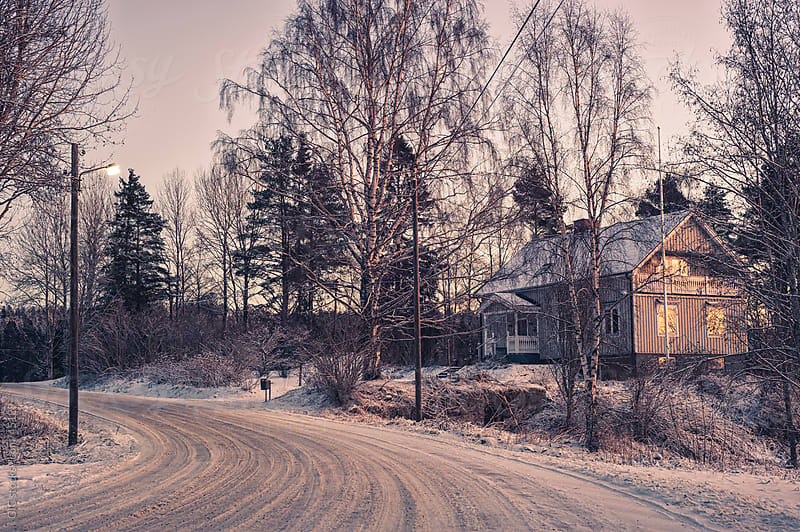 Cottage in wintry landscape, Sweden by GIC for Stocksy United
