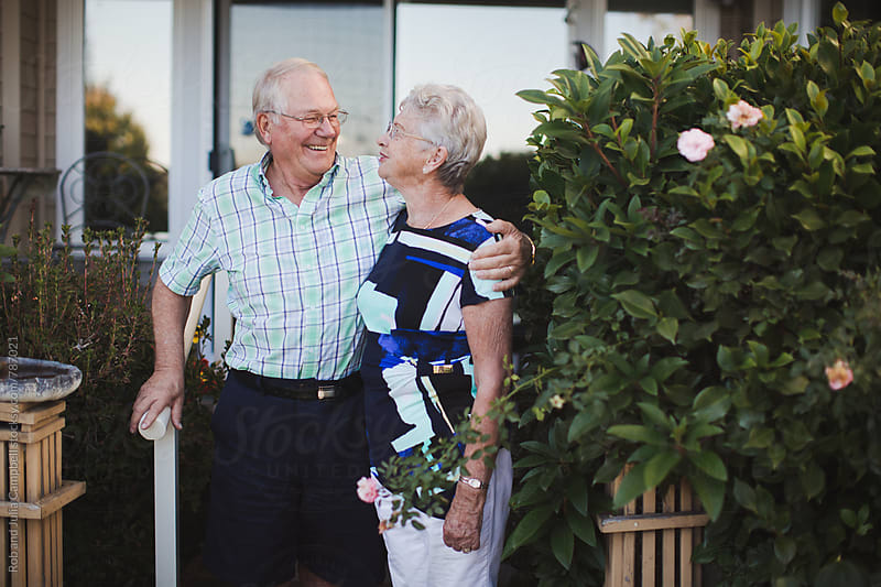 Happy senior couple outside enjoying life together by Rob and Julia Campbell for Stocksy United