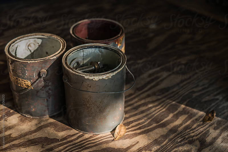 Old Vintage Paint Cans with collections of Harware and Nails by suzanne clements for Stocksy United