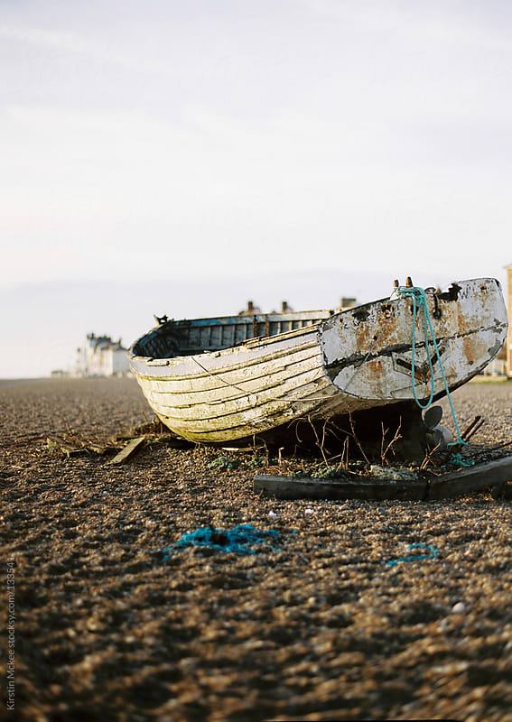 Boat on beach by Kirstin Mckee for Stocksy United