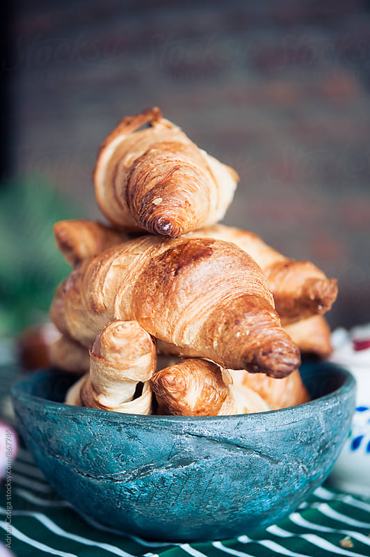 Croissants for breakfast by Adrian Cotiga for Stocksy United