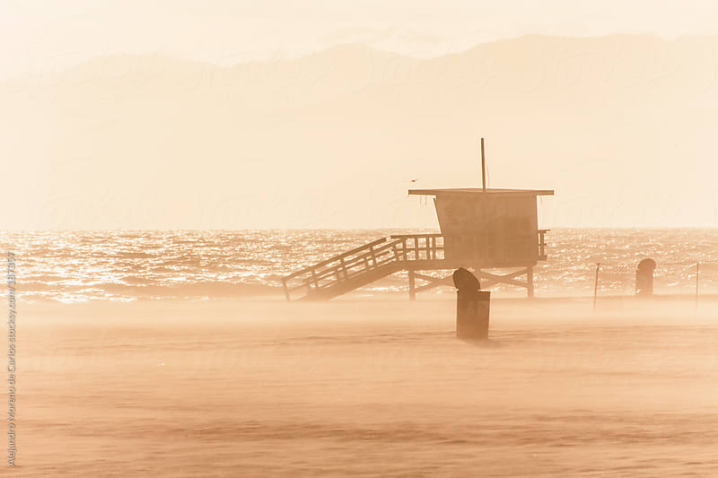 Lifeguard cabin at sunset on the beach in Los Angeles, California by Alejandro Moreno de Carlos for Stocksy United