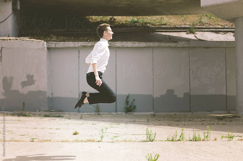 happy butch jumping . by Alexey Kuzma for Stocksy United