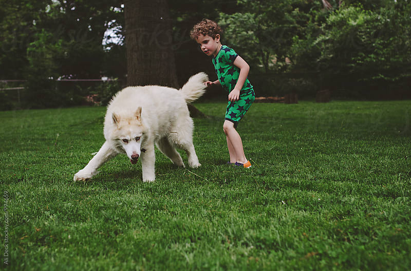 Boy and His Dog by Ali Deck for Stocksy United